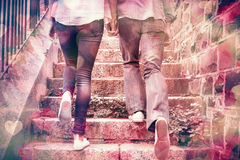 Hip young couple walking up steps Royalty Free Stock Photography