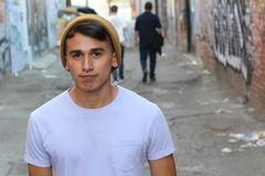 Hip young Hispanic man outdoors royalty free stock photography