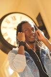 Hip young man listening to music with headphones royalty free stock photos