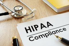 HIPAA Compliance application and stethoscope. HIPAA Compliance application and stethoscope on a desk royalty free stock photography