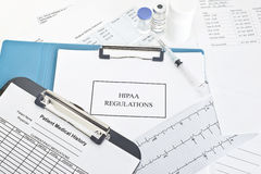 HIPAA Regulations. Manual with patient documents.  All labels and/or documents are fictitious.  Names, serial numbers, and/or dates, are random and any Royalty Free Stock Image