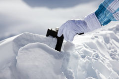 Hipflask in snow Stock Photos