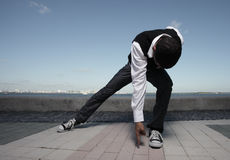 Hiphop dance moves. Young teenager performing hiphop dance moves Stock Photography