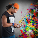 Hiphop style and music. Boy with hat listening to hiphop music Royalty Free Stock Image