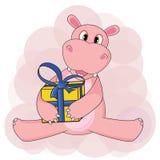 Hipopótamo que senta e que guarda o presente no fundo branco no vetor Foto de Stock