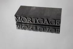 Hipoteca deletreada con el tipo reflexión del metal Imágenes de archivo libres de regalías