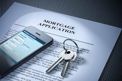 A hipoteca fecha o telemóvel Fotografia de Stock