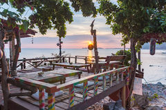 Hippie bar on a cliff over the sea in the sunset. Sunset from a waterfront hippie bar in Thailand, Esco bar at Sunset beach, Haad Rin, Koh Pangan, Thailand, May Stock Photo