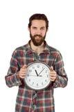 Hippie beau montrant une horloge photographie stock