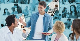 Hippie business people discussing against graph Royalty Free Stock Images