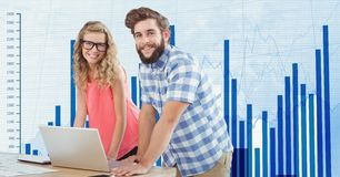 Hippie business people with laptop against graph. Digital composite of Hippie business people with laptop against graph Royalty Free Stock Photo