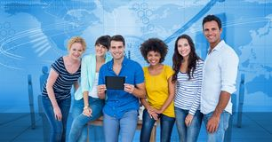 Hippie business people with tablet PC against graphs Stock Photo