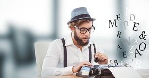Hippie businessman using typewriter while letters flying in office Stock Image