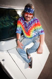 Hippie on a car Hood Stock Photography