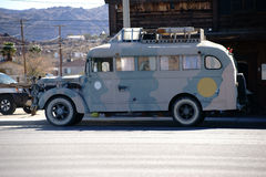 Hippie Caravan. An old hippie camper parked on a street outside a restaurant stock photos