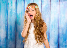 Hippie children girl shouting expression with hand in mouth Stock Images