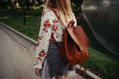 Hippie country backpack girl traveling stock photo