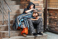 Hippie couple on the steps. Young hippie couple sitting on the steps Royalty Free Stock Photography