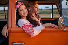 Hippie couple in a van on a road trip Stock Photo