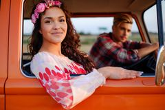 Hippie couple in a van on a road trip Stock Images