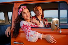 Hippie couple in a van on a road trip Royalty Free Stock Photo