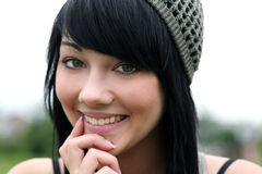 Hippie Dippy. Pretty brunette teen girl closeup smiling Stock Images