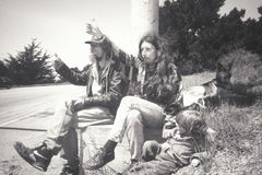 A hippie family hitchhiking on Highway 1 Royalty Free Stock Photo