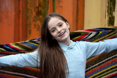 Hippie feeling. Teenage girl with old crochet shawl from grandmothers hippie time stock photo