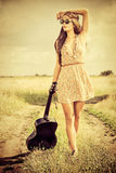 Hippie fredom. Romantic girl travelling with her guitar. Summer. Hippie style royalty free stock photography