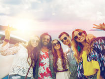 Hippie friends at minivan car showing peace sign Royalty Free Stock Photo