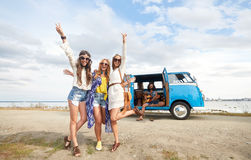Hippie friends near minivan car showing peace sign Royalty Free Stock Photography