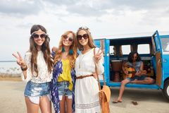 Hippie friends near minivan car showing peace sign Stock Photos