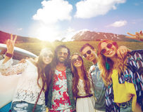 Hippie friends over minivan car showing peace sign Royalty Free Stock Photo