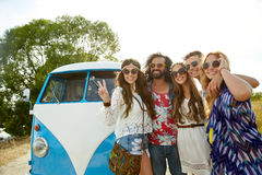 Hippie friends over minivan car showing peace sign Stock Photography