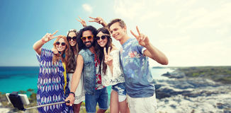 Hippie friends with smartphone on selfie stick Royalty Free Stock Photos
