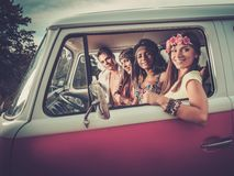 Hippie friends in a van Royalty Free Stock Photography