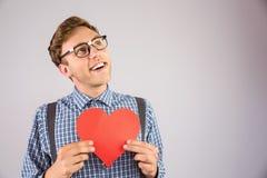Hippie Geeky tenant une carte de coeur Image libre de droits