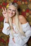 Hippie Girl. Pretty peace sign hippie girl stock images