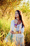 Hippie girl. Beautiful hippie girl in the tall grass Stock Photo