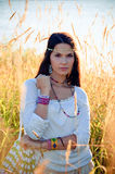 Hippie girl. Beautiful hippie girl stands in grass and looks to the camera Royalty Free Stock Image