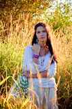 Hippie girl. Beautiful hippie girl in the tall grass Royalty Free Stock Images