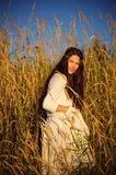 Hippie girl. Going into the grass Royalty Free Stock Photography