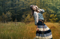 Hippie girl. On the background of beautiful scenery stock photos