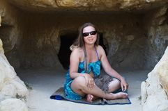Hippie girl. Hippie-like girl sitting in the cave in Matala Crete Stock Photo