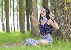 Hippie Girl Dreaming about Peace Stock Photography