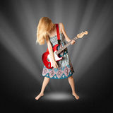Hippie girl with electric guitar Stock Photography