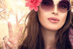 Hippie Girl enjoying Nature Showing Peace Hand Sign Royalty Free Stock Images