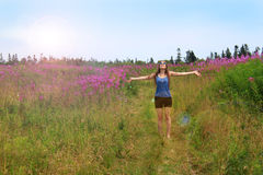 Hippie girl in field Stock Photography