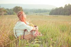 Hippie girl at golden field Stock Photos