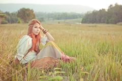 Hippie girl at golden field Stock Image